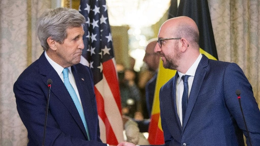 Secretary of State John Kerry shakes hands with Belgian Prime Minister Charles Michel after delivering a joint statement at the Belgian Prime Minister's Residence in Brussels, Belgium, Friday, March 25, 2016. Kerry is in Brussels to pay respect to victims of terrorist attacks that left more than 30 dead at Brussels Airport. (AP Photo/Andrew Harnik, Pool)