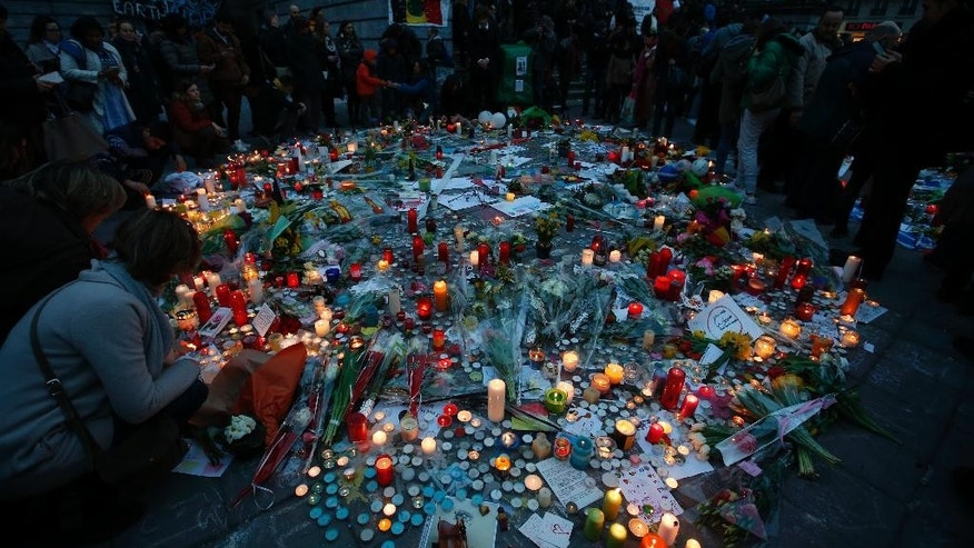 "A view of some of the tributes to the victims of the recent attacks in Brussels, placed in Place de la Bourse as dusk falls in the centre of Brussels, Thursday, March, 24, 2016. Belgium's prime minister is promising to do everything to determine who was responsible for deadly attacks targeting the Brussels airport and subway system. Charles Michel, in a national mourning speech Thursday, said Tuesday's attacks on the European Union's capital targeted the ""liberty of daily life"" and ""the liberty upon which the European project was built.""(AP Photo/Alastair Grant)"