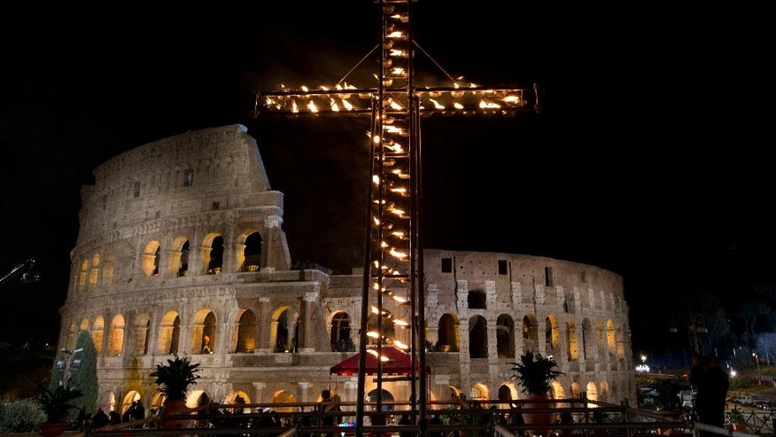 A view of the Colosseum prior to the arrival of Pope Francis to lead the Via Crucis (Way of the Cross) torchlight procession celebrated at the Colosseum on Good Friday in Rome, Friday, March 25, 2016. The evening Via Crucis procession at the ancient amphitheater is a Rome tradition that draws a large crowd of faithful, including many of the pilgrims who flock to the Italian capital for Holy Week ceremonies before Easter Sunday. (AP Photo/Andrew Medichini)