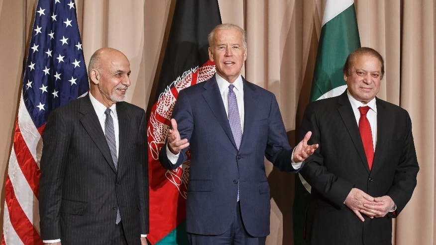 FILE - In this Jan. 21, 2016 file photo, U.S. Vice President Joe Biden, center, poses with Afghan President Ashraf Ghani, left, and Pakistani Prime Minister Nawaz Sharif for the media prior to a meeting on the sidelines of the World Economic Forum in Davos, Switzerland. Prospects of peace talks between the Afghan government and the Taliban are becoming increasingly dim amid recent battlefield gains by the insurgents, an embattled government in Kabul and suspicions about Pakistan's good intentions in facilitating such negotiations. (AP Photo/Michel Euler, File)