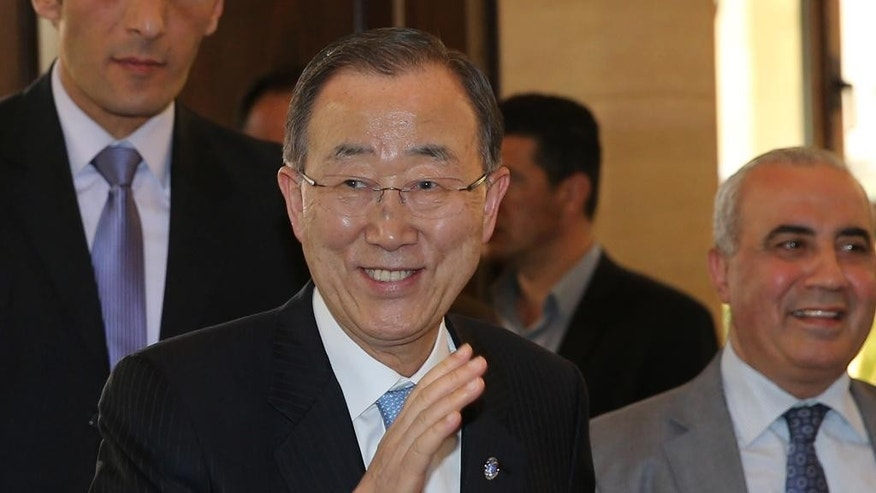 United Nations Secretary-General Ban Ki-moon waves to journalists on his arrival to meet with Lebanese parliament speaker Nabih Berri, in Beirut, Lebanon, Thursday, March 24, 2016. The U.N. chief arrived in Lebanon on an official visit that comes as the U.N.-brokered peace talks in Geneva between the Syrian government and the opposition are to adjourn until later in April. Ban will meet top Lebanese officials and address refugee support, youth unemployment, and private sector development. (AP Photo/Hussein Malla)