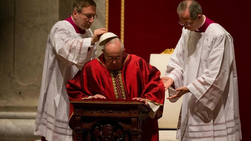 Pope Francis prays during the celebration of the Lord's Passion, in St. Peter's Basilica at the Vatican Friday, March 25, 2016. (AP Photo/Alessandra Tarantino)