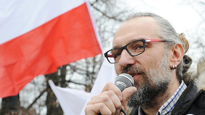 FILE - A  Dec. 19, 2015, file photo showingMateusz Kijowski, leader of the Committee for the Defense of Democracy, speaking at a demonstration in Warsaw, Poland. Kijowski's group, which is supported by many former Solidarity activists and embraces the same values of nonviolent resistance, has organized a string of protests over the past month that have brought many thousands of people to the streets.  (AP Photo/Alik Keplicz, File)