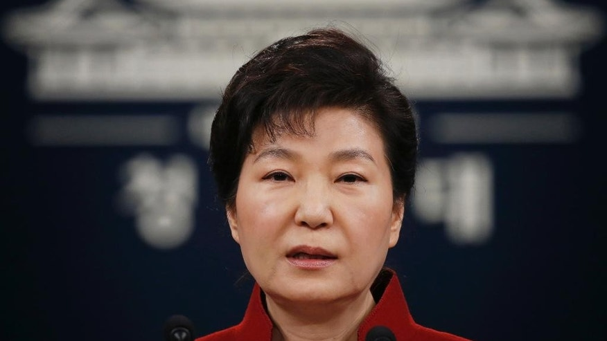 "FILE - In this Jan. 13, 2016, file photo, South Korean President Park Geun-hye addresses the nation during her news conference at the Presidential Blue House in Seoul, South Korea. Upping its rhetoric a notch, North Korea warned Saturday, March 26, 2016, that it will attack Seoul's presidential palace unless it receives an apology from South Korean President Park for ""treason."" The warning is the latest threat against Washington and Seoul over joint U.S.-South Korean military drills now underway that the North sees as a dress rehearsal for invasion. (Kim Hong-ji/Pool Photo via AP, File)"