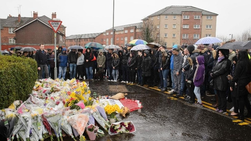 "A vigil is held outside the shop where Asad Shah worked in Glasgow, Saturday March 26, 2016. Scottish police say the killing of a Muslim shopkeeper who wished Christians a happy Easter is being investigated as ""religiously prejudiced."" Vigils were held Friday and Saturday in memory of 40-year-old Asad Shah, who was killed Thursday night in Glasgow. (John Linton/PA via AP) UNITED KINGDOM OUT"