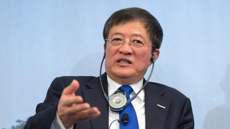 FILE - In this Feb. 3, 2016, file photo, Ren Jianxin, chairman of ChemChina (China National Chemical Corporation), speaks during an annual press conference of agrochemical company Syngenta in Basel, Switzerland. The tycoon who is offering $43 billion for Swiss agrochemicals giant Syngenta keeps a low profile but is China's most aggressive dealmaker. (Georgios Kefalas/Keystone via AP, File)