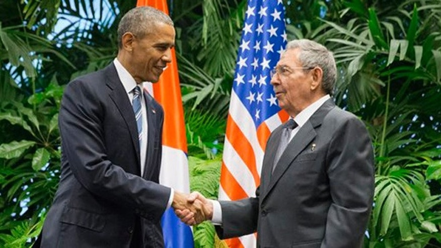 FILE - In this March 21, 2016 file photo, President Barack Obama shakes hands with Cuban President Raul Castro during their meeting at the Palace of the Revolution in Havana, Cuba. (AP Photo/Pablo Martinez Monsivais, File)