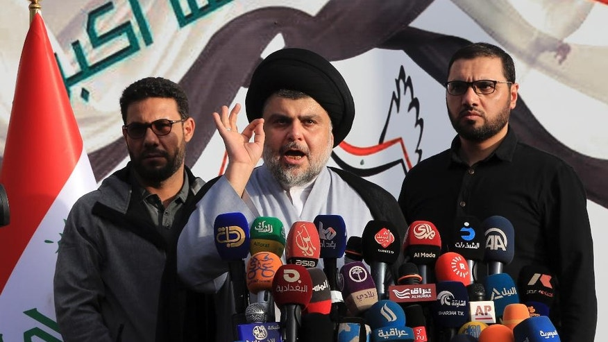 Shiite cleric Muqtada al-Sadr, center, gives a speech to his supporters before entering the highly fortified Green Zone, in Baghdad, Iraq, Sunday, March, 27, 2016. Al-Sadr brushed past security checkpoints to enter Baghdad's highly fortified Green Zone Sunday after weeks of protests in the Iraqi capital. (AP Photo/Karim Kadim)