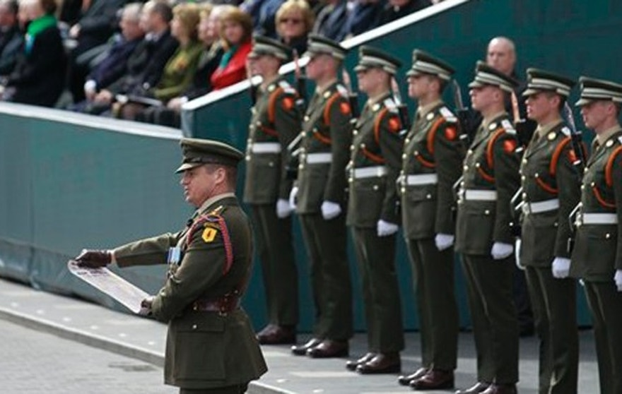 Captain Peter Kelleher from the 27th Infantry Battalion reads the Proclamation at the General Post Office on O'Connell street, Dublin, Ireland, Sunday, March, 27, 2016.  Thousands of soldiers marched solemnly Sunday through the crowded streets of Dublin to commemorate the 100th anniversary of Ireland's Easter Rising against Britain, a fateful rebellion that reduced parts of the capital to ruins and inspired the country's eventual independence. (AP Photo/Peter Morrison)