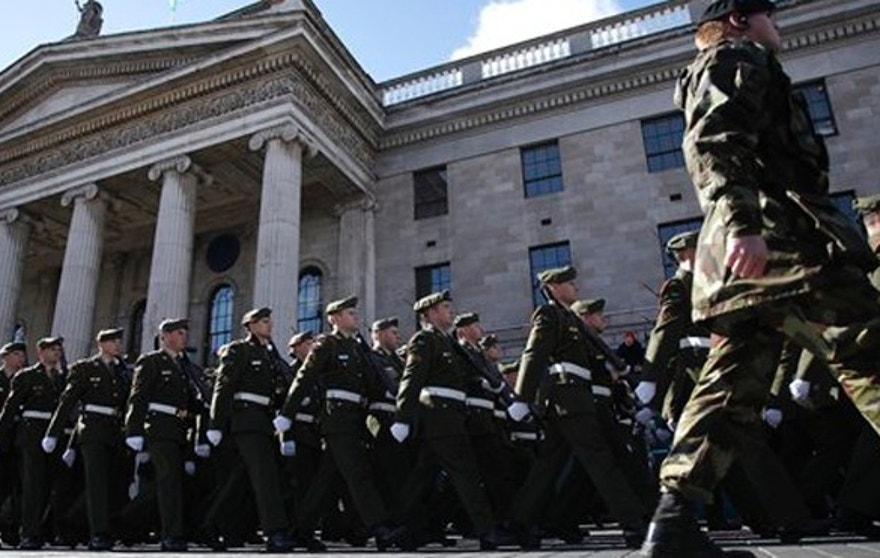 Thousands of soldiers march through the streets of Dublin, Ireland, Sunday, March 27, 2016.  Thousands of soldiers marched solemnly Sunday through the crowded streets of Dublin to commemorate the 100th anniversary of Ireland's Easter Rising against Britain, a fateful rebellion that reduced parts of the capital to ruins and inspired the country's eventual independence. (AP Photo/Peter Morrison)