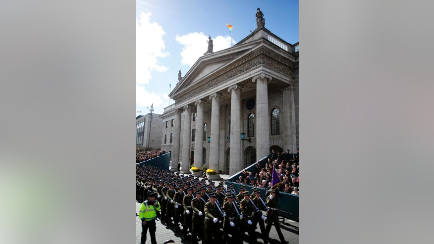 Soldiers march through the streets of Dublin, Ireland, Sunday, March, 27, 2016.  Thousands of soldiers marched solemnly Sunday through the crowded streets of Dublin to commemorate the 100th anniversary of Ireland's Easter Rising against Britain, a fateful rebellion that reduced parts of the capital to ruins and inspired the country's eventual independence. (AP Photo/Peter Morrison)