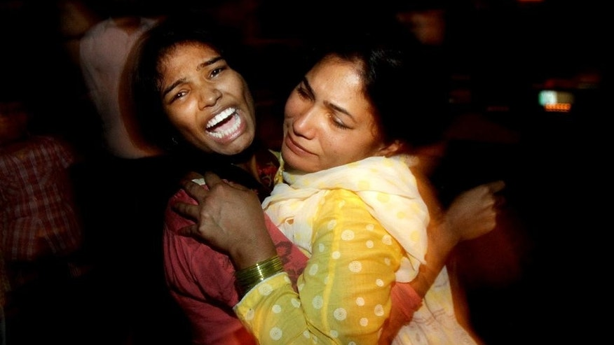 Women comfort each other as they mourn over the death of a family member who was killed in a bomb blast, at a local hospital in Lahore, Pakistan, Sunday, March, 27, 2016. A bomb blast in a park in the eastern Pakistani city of Lahore has killed tens of people and wounded scores, a health official said. (AP Photo/K.M. Chuadary)