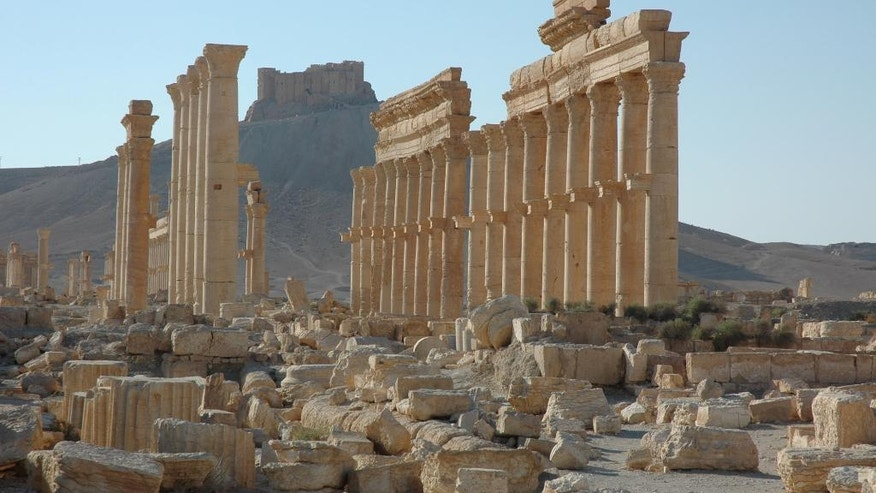 FILE - This undated file image released by UNESCO shows the site of the ancient city of Palmyra in Syria. Palmyra is an archaeological gem that Syrian troops took back from Islamic State fighters, Sunday, March 27, 2016. A desert oasis surrounded by palm trees in central Syria, Palmyra is also a strategic crossroads linking the Syrian capital, Damascus with the country's east and neighboring Iraq. Home to 65,000 people before the latest fighting, the town is located 155 miles (215 kilometers) east of Damascus.  (Ron Van Oers, UNESCO via AP, File)