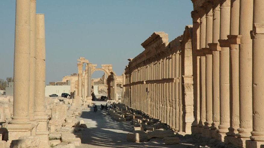FILE - This undated file image released by UNESCO shows the site of the ancient city of Palmyra, Syria. Palmyra is an archaeological gem that Syrian troops took back from Islamic State fighters, Sunday, March 27, 2016. A desert oasis surrounded by palm trees in central Syria, Palmyra is also a strategic crossroads linking the Syrian capital, Damascus with the country's east and neighboring Iraq. Home to 65,000 people before the latest fighting, the town is located 155 miles (215 kilometers) east of Damascus. (Ron Van Oers, UNESCO via AP, File)