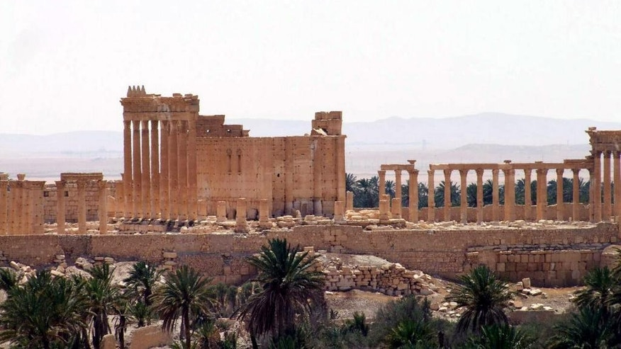 FILE -- This file photo released May 17, 2015, by the Syrian official news agency SANA, shows a general view of Palmyra, Syria. Palmyra is an archaeological gem that Syrian troops took back from Islamic State fighters, Sunday, March 27, 2016. A desert oasis surrounded by palm trees in central Syria, Palmyra is also a strategic crossroads linking the Syrian capital, Damascus with the country's east and neighboring Iraq. Home to 65,000 people before the latest fighting, the town is located 155 miles (215 kilometers) east of Damascus. (SANA via AP, File)
