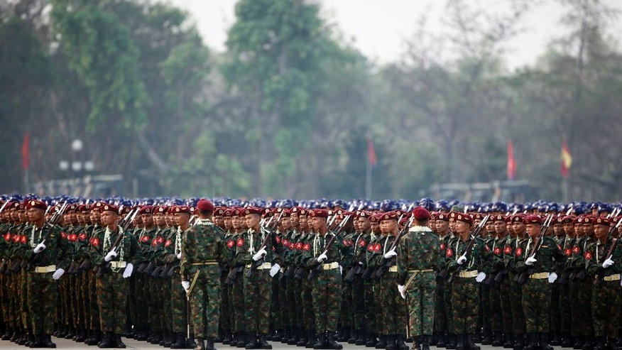 Myanmar military officers stand in lines during a parade to commemorate 71st Armed Forces Day in Naypyitaw, Myanmar, Sunday, March 27, 2016. The country's commander-in-chief, General Min Aung Hlaing, addressed the parade saying that principles of democracy mean holding elections that some parties win and others lose. It is the first time the event has been held since Aung San Suu Kyi's National League for Democracy (NLD) party became the ruling party winning November 2015 elections.(AP Photo/Aung Shine Oo)