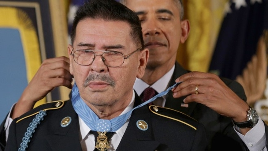 WASHINGTON, DC - MARCH 18:  U.S. Army Specialist Four (Ret.) Santiago Erevia, a Vietnam War veteran, receives the Medal of Honor from President Barack Obama in the East Room of the White House on March 18, 2014 in Washington, DC. ÃÅ Erevia, Army Sergeant First Class (Ret.) Jose Rodela and Army Staff Sgt. (Ret.) Melvin Morris were joined by the families of 21 others who were presented posthumously with the Medal of Honor. Following a congressionally mandated review to ensure that eligible recipients were not bypassed due to prejudice the veterans received the Medal of Honor for action during major combat operations in World War II, the Korean War and the Vietnam War.  (Photo by Chip Somodevilla/Getty Images)