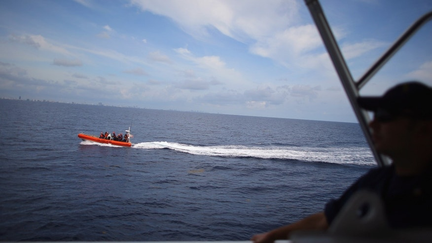 MIAMI BEACH, FL - OCTOBER 17:  The 7.9-meter small boat moves past the United States Coast Guard Cutter William Flores after it was launched from the launch ramp on the back of the ship on October 17, 2012  just off shore Miami Beach, Florida. The cutter is the third of a planned 58 Fast Response Cutters in the Sentinel Class as the U.S. Coast Guard continues to replace its aging fleet. On November 3, the USCGC William Flores will be commissioned into service in Tampa, Florida.  (Photo by Joe Raedle/Getty Images)