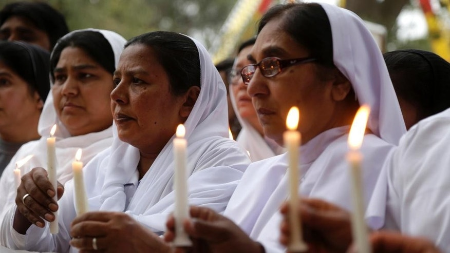 Pakistani nuns hold candles during a vigil for victims of Sunday's deadly suicide bombing in a park, Monday, March 28, 2016 in Lahore, Pakistan. Pakistan's prime minister on Monday vowed to eliminate perpetrators of terror attacks such as the massive suicide bombing that targeted Christians gathered for Easter the previous day in the eastern city of Lahore, killing at least 70 people. (AP Photo/K.M. Chaudary)