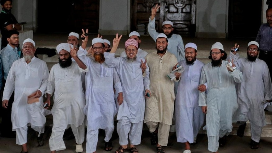 Leaders of a Bangladeshi Islamic group show victory sign after Bangladesh's top court rejected a 28-year-old petition Monday to remove Islam as the official religion of the Muslim-majority South Asian nation in Dhaka, Bangladesh, Monday, March 28, 2016. (AP Photo/ A.M. Ahad)