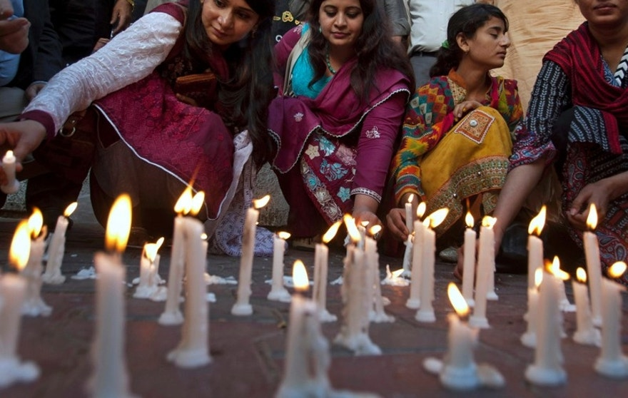 Members of a civil society group light candles during a vigil for the victims of Sunday's suicide bombing, Monday, March 28, 2016 in Karachi, Pakistan. Pakistan's prime minister vowed to eliminate perpetrators of terror attacks such as the massive suicide bombing that targeted Christians gathered for Easter the previous day in the eastern city of Lahore, killing tens of people. (AP Photo/Shakil Adil)