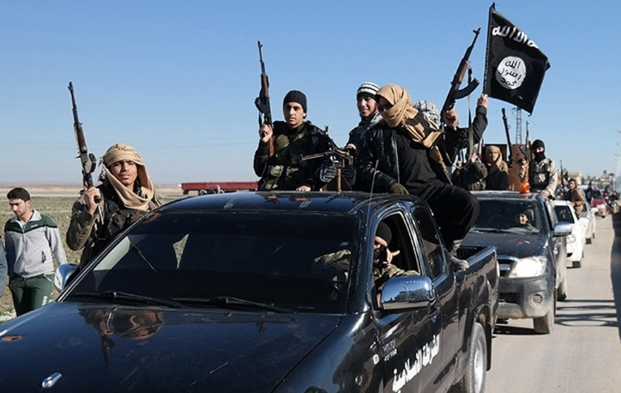 FILE - In this this file photo released on May 4, 2015, on a militant website, which has been verified and is consistent with other AP reporting, Islamic State militants pass by a convoy in Tel Abyad, northeast Syria. Germany's federal criminal police said Thursday, March 10, 2016 they are in possession of files containing personal data on members of the extremist Islamic State group and believe them to be authentic. (Militant website via AP, File)