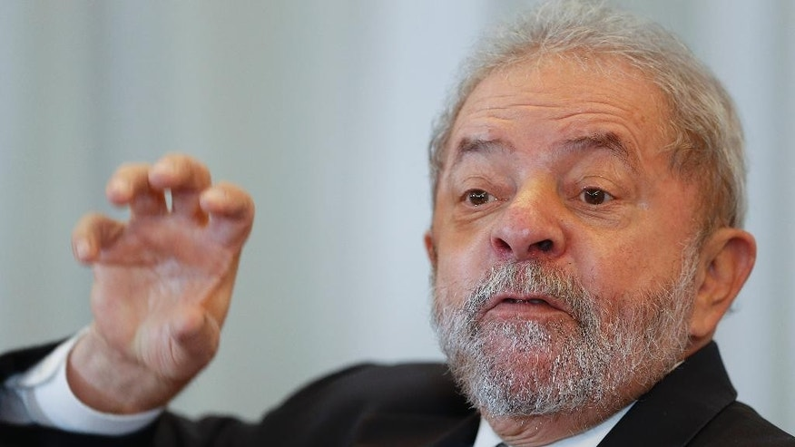 Brazil's former President Luiz Inacio Lula da Silva speaks during a news conference with foreign journalists  in Sao Paulo, Brazil, Monday, March 28, 2016. Lula da Silva has been recently linked to a sprawling corruption investigation with ties to the Brazilian oil giant Petrobras. (AP Photo/Andre Penner)