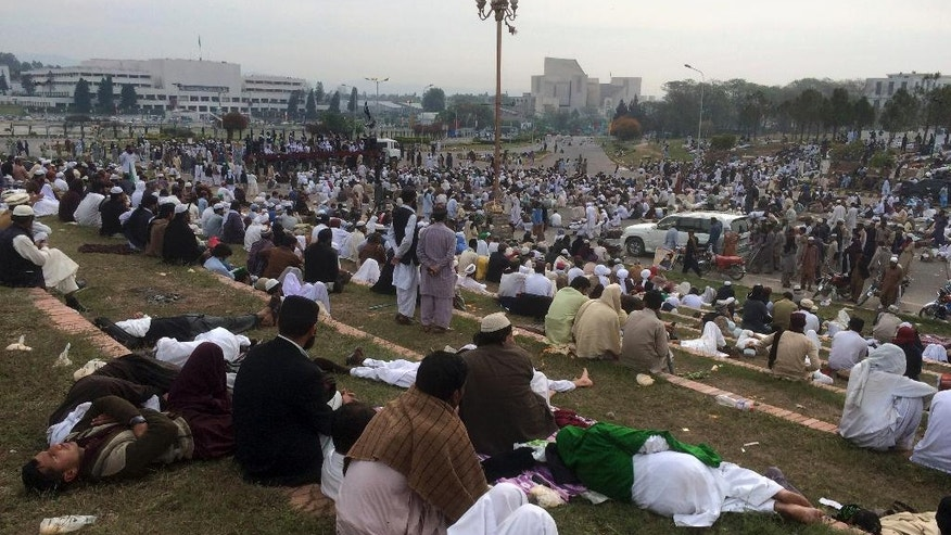Supporters of the religious party Sunni Tehreek hold sit-in protest outside the parliament building in Islamabad, Pakistan, Monday, March 28, 2016. Thousands of demonstrators marched into the Pakistani capital to protest the hanging of Qadri, charged with murdering a secular governor. Police officer Muhammad Nasim said that the march of thousands people was peaceful initially, but as the crowds reached an avenue leading to parliament the protesters turned violent, smashing windows and damaging bus stations. (AP Photo/Anjum Naveed)