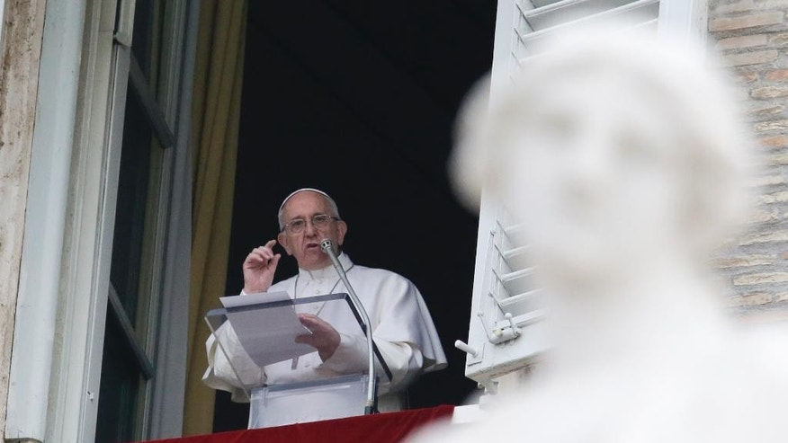 Pope Francis delivers the Regina Coeli prayer from his studio's window overlooking St. Peter's Square, at the Vatican, Monday, March 28, 2106. The pontiff is decrying what he calls the ''vile'' and ''abominable'' Easter Sunday bombing in a Pakistani park targeting Christians and insisting religious minorities be protected. (AP Photo/Gregorio Borgia)