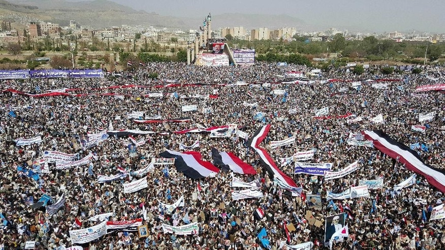 Supporters of Yemen's former President Ali Abdullah Saleh, who are allies of Shiite rebels known as Houthis, attend a rally to mark the first anniversary of the Saudi-led military campaign against them, in Sanaa, Yemen, Saturday, March 26, 2016. On Friday, in his first speech in months, the leader of the Houthi rebels, Abdul-Malek al-Houthi, called for street rallies to mark the occasion. Yet his tone was comparatively subdued, suggesting that the Houthis are under pressure following yearlong airstrikes and a ground operation that have killed thousands of civilians. (AP Photo/Hani Mohammed)