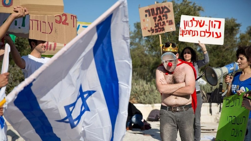 File - In this Sunday, Feb. 14, 2016  file photo, an activist wears a mask bearing a portrait of Prime Minister Benjamin Netanyahu during a protest against a natural gas deal signed in December, 2015 with U.S. and Israeli developers for drilling offshore gas deposits, in front of the Supreme Court in Jerusalem. Israel's Supreme Court has ruled against the governments framework deal for its natural gas reserves granting a year for issues to be worked out on Sunday, March 27, 2016.  (AP Photo/Ariel Schalit, File)