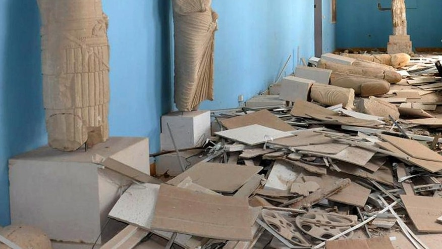 This photo released on Sunday March 27, 2016, by the Syrian official news agency SANA, shows destroyed statues at the damaged Palmyra Museum, in Palmyra city, central Syria. The amount of destruction found inside the archaeological area in the historic town  was similar to what experts have expected but the shock came Monday from inside the local museum where the extremists have caused wide damage demolishing invaluable statues that were torn to pieces. (SANA via AP)
