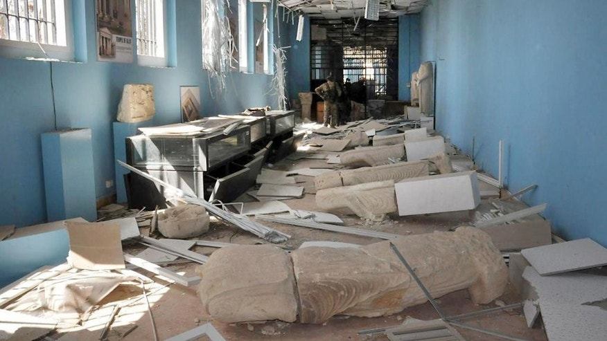 This photo released on Sunday March 27, 2016, by the Syrian official news agency SANA, shows destroyed statues at the damaged Palmyra Museum, in Palmyra city, central Syria. The amount of destruction found inside the archaeological area in the historic Syrian town of Palmyra was similar to what experts have expected but the shock came Monday, March 28, 2016 from inside the local museum where the extremists have caused wide damage demolishing invaluable statues that were torn to pieces. (SANA via AP)