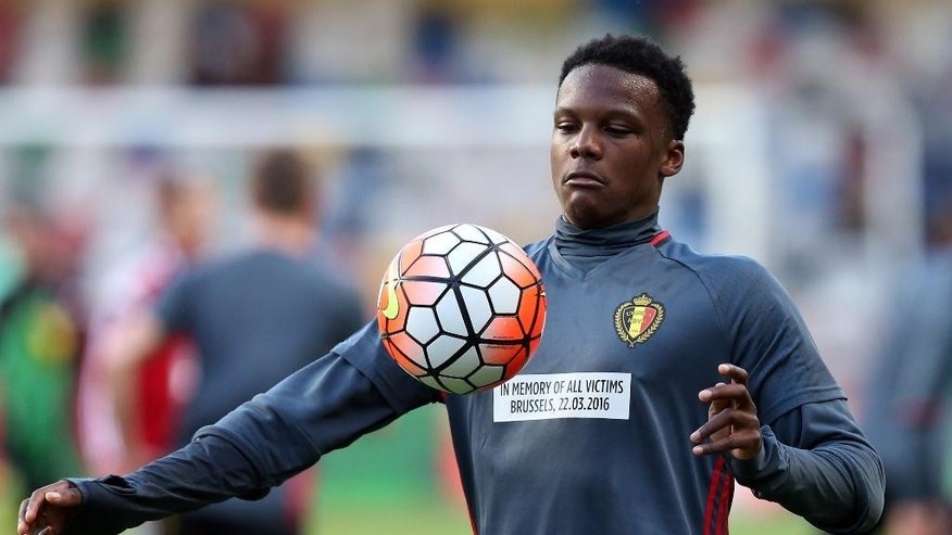 Belgium's Dedryck Boyata warms up wearing a shirt with a message remembering the victims of the recent attacks in Brussels  before a friendly soccer match between Portugal and Belgium in Leiria, Portugal, Tuesday, March 29 2016. (AP Photo/Steven Governo)