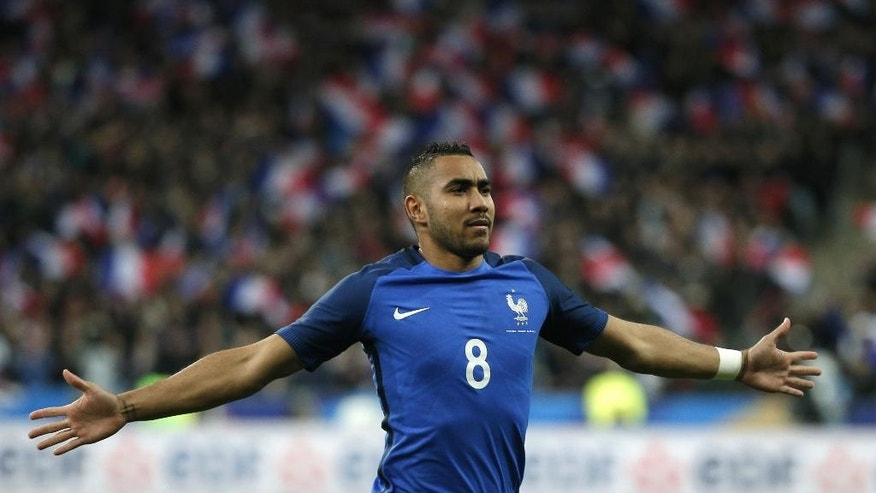 France's Dimitri Payet celebrates his side's 3rd goal during the international friendly soccer match between France and Russia in Saint Denis, north of Paris, France, Tuesday, March 29, 2016. (AP Photo/Thibault Camus)