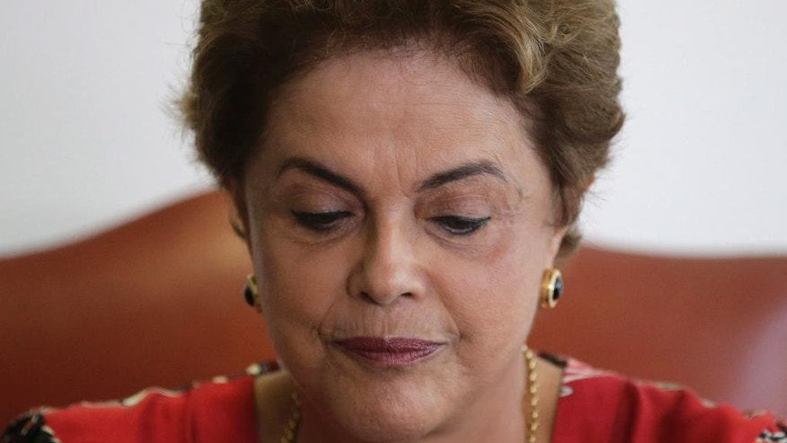 Brazil's President Dilma Rousseff attends a meeting with Brazilian Ambassador Roberto Azevedo, director general of the World Trade Organization, at the Planalto Presidential Palace, in Brasilia, Tuesday, March 29, 2016. Former Brazilian President Luiz Inacio Lula da Silva said Monday that he believes Rousseff, his embattled successor and protege, can survive mounting pressure in Congress for her impeachment. Rousseff recently appointed Silva as her chief of staff in a much-discussed move that still must be confirmed by Brazil's top court. (AP Photo/Eraldo Peres)
