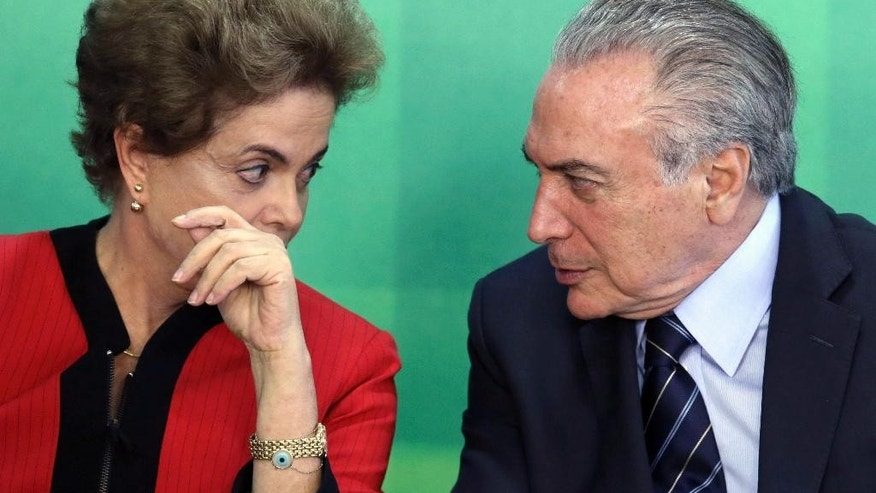FILE - In this March 2, 2016 file photo, Brazil's President Dilma Rousseff talks with her Vice President Michel Temer, during a meeting at the Planalto Presidential Palace, in Brasilia, Brazil. The Brazilian Democratic Movement Party, (PMDB), of which Temer is the leader, said on Tuesday, March 29, 2016, that its members are leaving Rousseff's governing coalition. (AP Photo/Eraldo Peres, File)