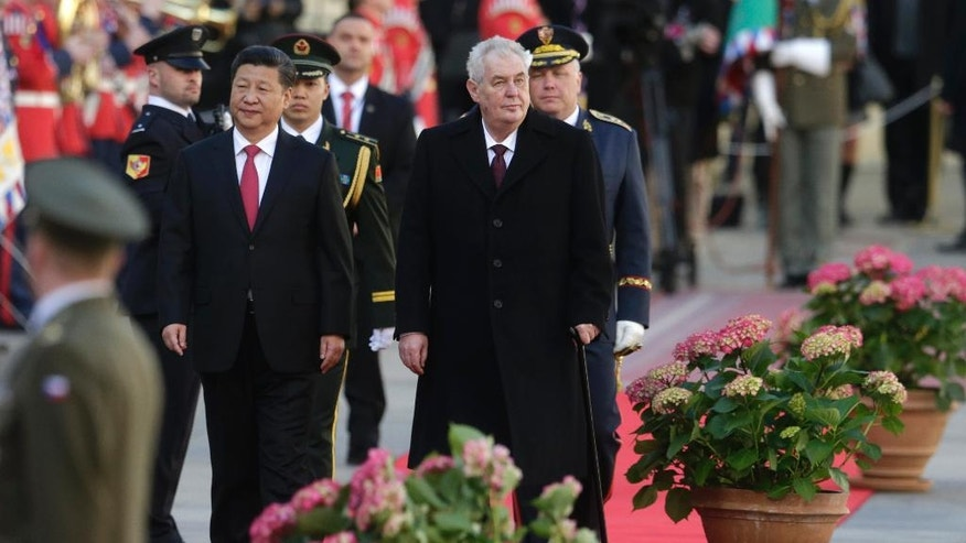 Czech Republic's President Milos Zeman, right, welcomes his Chinese counterpart Xi Jinping, left, at the Prague Castle in Prague, Czech Republic, Tuesday, March 29, 2016. (AP Photo/Petr David Josek)