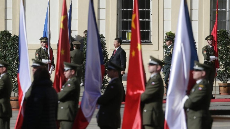 Chinese President Xi Jinping, rear center, arrives at the Prague Castle in Prague, Czech Republic, Tuesday, March 29, 2016. (AP Photo/Petr David Josek)