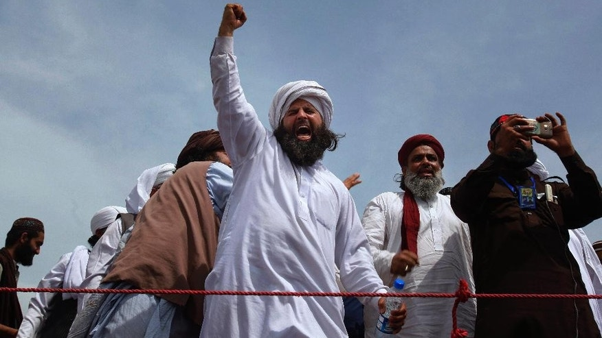 A protestesr from Pakistan's Sunni Tehreek group chants slogans during a sit-in near the parliament building in Islamabad, Pakistan, Tuesday, March 29, 2016. Hundreds of Islamic extremists who earlier violently protested in Islamabad over the hanging of a man who killed a secular governor continued their demonstrations in Pakistan's capital on Tuesday, bringing the most sensitive parts of the capital to a standstill. (AP Photo/Anjum Naveed)