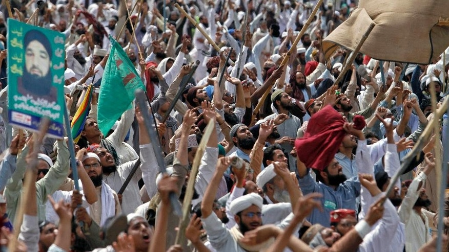 Protesters from Pakistan's Sunni Tehreek group chant slogans during a sit-in near the parliament building in Islamabad, Pakistan, Tuesday, March 29, 2016. Hundreds of Islamic extremists who earlier violently protested in Islamabad over the hanging of a man who killed a secular governor continued their demonstrations in Pakistan's capital on Tuesday, bringing the most sensitive parts of the capital to a standstill. (AP Photo/Anjum Naveed)