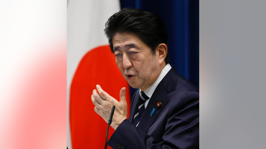 Japanese Prime Minister Shinzo Abe speaks to the media during a press conference at his official residence in Tokyo, Tuesday, March 29, 2016. The Prime Minister says there is no change to a planned consumption tax hike next year, denying a growing speculation of a postponement amid suggestions that Japan's economy is not ready for another one. (AP Photo/Shizuo Kambayashi)