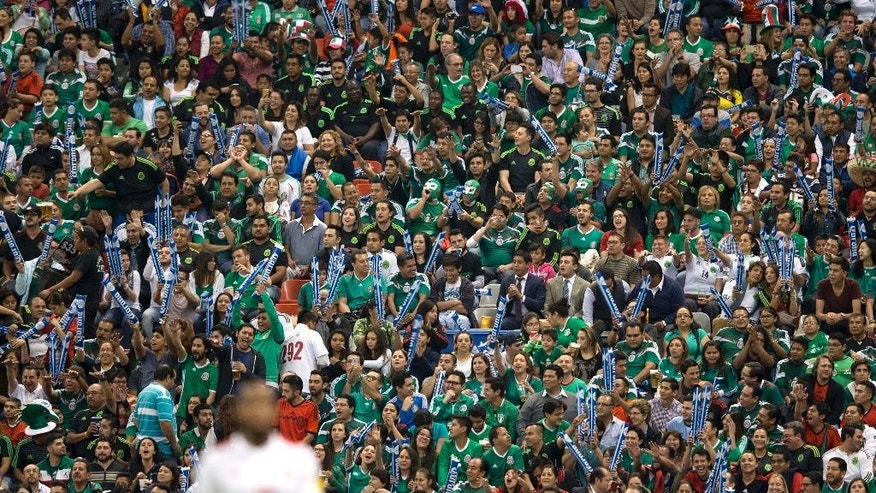 Mexico soccer fans cheer during a 2018 World Cup qualifying match against Canada in Mexico City, Tuesday, March 29, 2016. The Mexican Soccer Federation launched a campaign Tuesday urging fans to refrain from anti-gay chants that drew fines from FIFA earlier this year. (AP Photo/Eduardo Verdugo)