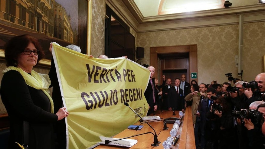 Paola, the mother of Giulio Regeni,  holds a banner reading: Truth for Giulio Regeni, prior to the start of a press conference held at the Italian Senate, in Rome, Tuesday, March 29, 2016. Giulio Regeni, 28, an Italian doctoral student disappeared in Cairo on Jan. 25, the anniversary of Egypt's 2011 uprising, a day when security forces were on high alert and on the streets in force to prevent any demonstrations or protests. His body, stabbed repeatedly and exhibiting cigarette burns and other signs of torture, was reported found on Feb. 3. (AP hoto/Gregorio Borgia)