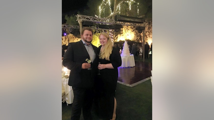 This 2015 family photo shows Alexander Pinczowski and his fiance Cameron Cain in Greece. Victims of the attacks on Brussels' airport and subway included commuters heading to work and travelers setting off on long-anticipated vacations. They came from dozens of nations to a city that's home to the European Union, NATO and other international institutions. Alexander and Sascha Pinczowski, Dutch nationals who lived in the U.S., were headed home to the United States when a bomb exploded at the Brussels airport Tuesday morning. Alexander, 29, was on the phone with his mother in the Netherlands when the line went dead, said James Cain, whose daughter Cameron was engaged to Alexander. (Courtesy of the family via AP)