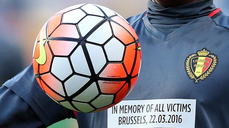 A close up of Belgium's Dedryck Boyata shirt with a message remembering the victims of the recent attacks in Brussels as he warms up before a friendly soccer match between Portugal and Belgium in Leiria, Portugal, Tuesday, March 29 2016. (AP Photo/Steven Governo)