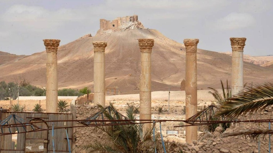 This photo released on Sunday March 27, 2016, by the Syrian official news agency SANA, shows a general view of Palmyra citadel, central Syria. Palmyra is an archaeological gem that Syrian troops took back from Islamic State fighters in central Syria. The amount of destruction found inside the archaeological area in the historic Syrian town of Palmyra was similar to what experts have expected but the shock came Monday from inside the local museum where the extremists have caused wide damage demolishing invaluable statues that were torn to pieces. (SANA via AP)