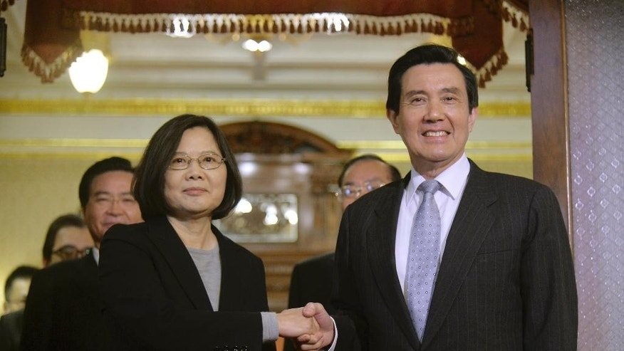 Taiwan's President-elect Tsai Ing-wen, left, poses with incumbent President Ma Ying-jeou at the official guest house after a courtesy call in Taipei, Taiwan, Wednesday, March 30, 2016. In opening remarks, incumbent President Ma Ying-jeou congratulated Tsai on her January election win as the island republic's first female head of state and said Taiwan faced a range of challenges and both parties were responsible or ensuring the people's welfare. (Sun Chung-ta, Pool Photo via AP)