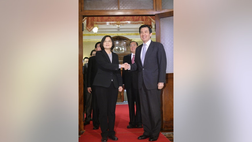 Taiwan's President-elect Tsai Ing-wen, left, poses with incumbent President Ma Ying-jeou at the official guest house after a courtesy call in Taipei, Taiwan, Wednesday, March 30, 2016. In opening remarks, Ma congratulated Tsai on her January election win as the island republic's first female head of state and said Taiwan faced a range of challenges and both parties were responsible or ensuring the people's welfare. (Sun Chung-ta, Pool Photo via AP)