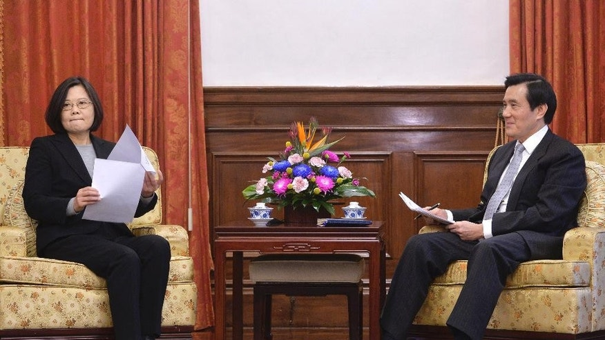 Taiwan's President-elect Tsai Ing-wen, left, sits with incumbent President Ma Ying-jeou at the official guest house during a courtesy call in Taipei, Taiwan, Wednesday, March 30, 2016. Taiwan's present and future presidents are emphasizing the need for a smooth transition of power amid an economic slowdown and sensitive relations with China. (Sun Chung-ta/Pool Photo via AP)